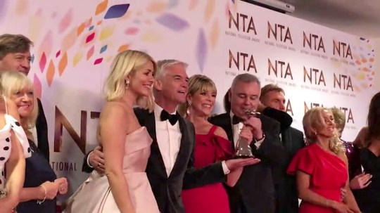 Eamonn Holmes yanks NTA out of Phillip Schofield's hand