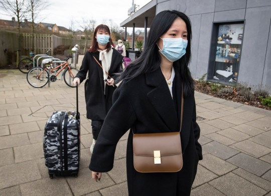 Two women wearing face masks leave the Staycity Hotel in the centre of York, after the apartment-hotel was put on lockdown on Wednesday night, when a man, understood to be a Chinese national, who was a guest at the facility, was taken to hospital, together with family members, after falling ill. PA Photo. Picture date: Friday January 31, 2020. The first cases of the coronavirus have been diagnosed in the UK, with two people from the same family being treated at a specialist centre. The announcement was made as more than 80 Britons on an evacuation flight from the Chinese city at the centre of the outbreak were due to land in the UK. See PA story HEALTH Coronavirus. Photo credit should read: Danny Lawson/PA Wire