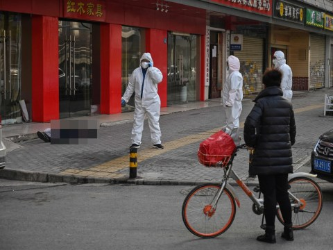 Man lies dead in the street in crisis-hit coronavirus city of Wuhan