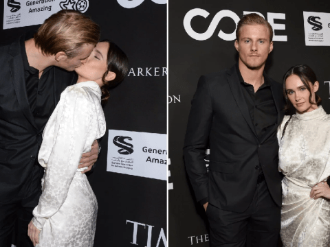 Vikings star Alexander Ludwig puckers up for a passionate kiss with co-star girlfriend on red carpet