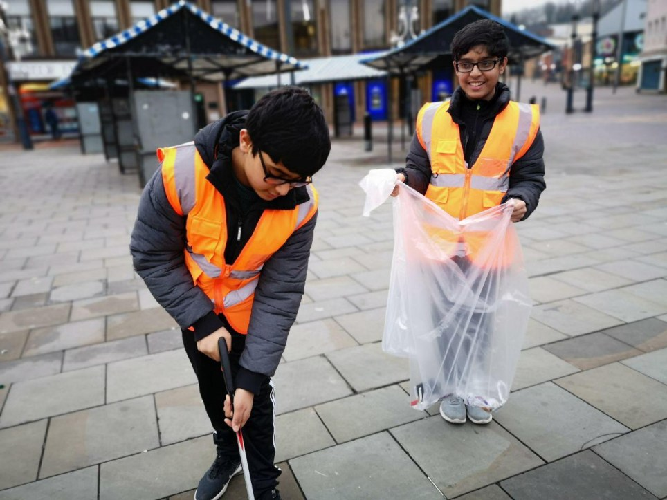 Young Muslims take to streets to clean up after New Year's Eve celebrations