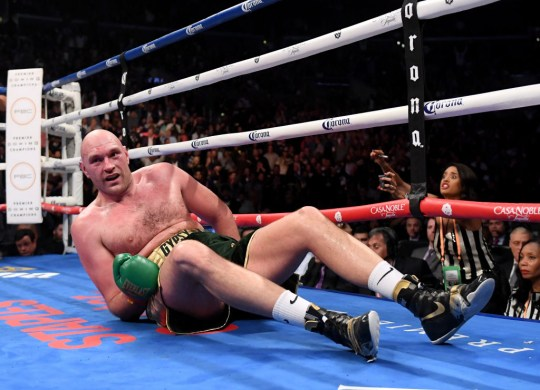 Tyson Fury knocked down by Deontay Wilder