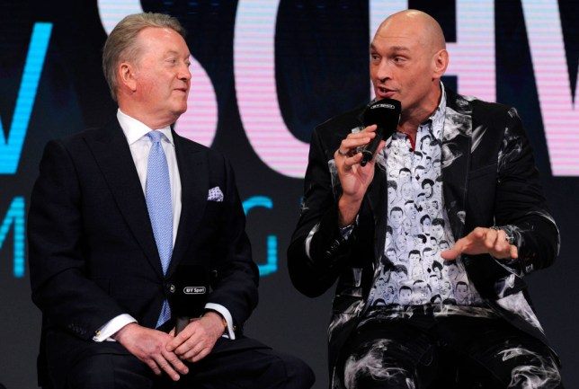 Frank Warren sits alongside Tyson Fury during a boxing press conference