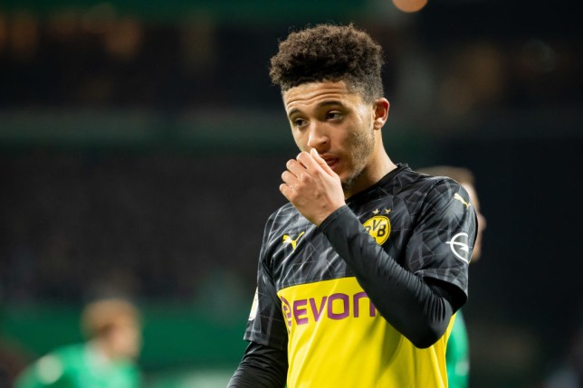 Jadon Sancho touches his nose during a Dortmund game