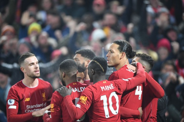 Liverpool players celebrate scoring a goal
