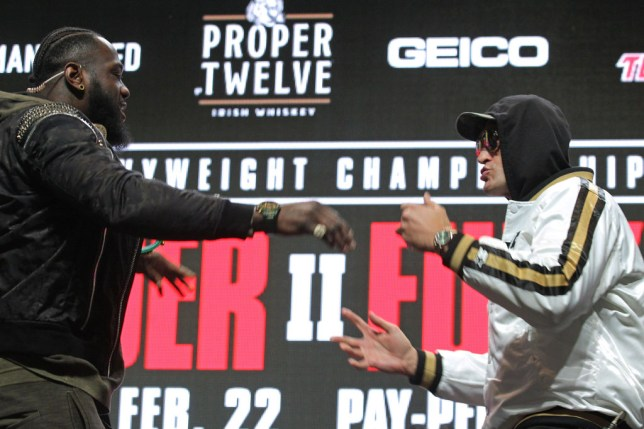 Tyson Fury is pushed by Deontay Wilder during their face-off