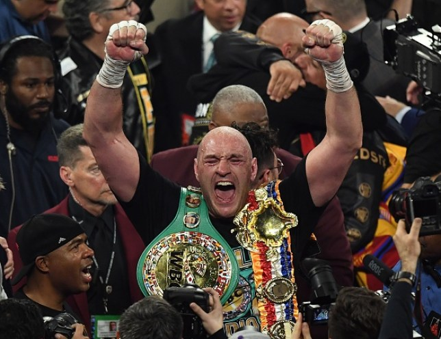 British boxer Tyson Fury celebrates after defeating US boxer Deontay Wilder in the seventh round during their World Boxing Council (WBC) Heavyweight Championship Title boxing match at the MGM Grand Garden Arena in Las Vegas