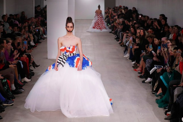 A model walks the runway at the On|Off Huang show during London Fashion Week