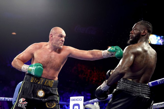 Deontay Wilder avoids a punch from Tyson Fury in their heavyweight fight