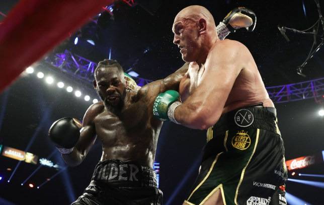Tyson Fury beat Deontay Wilder in seven rounds to win the WBC heavyweight title