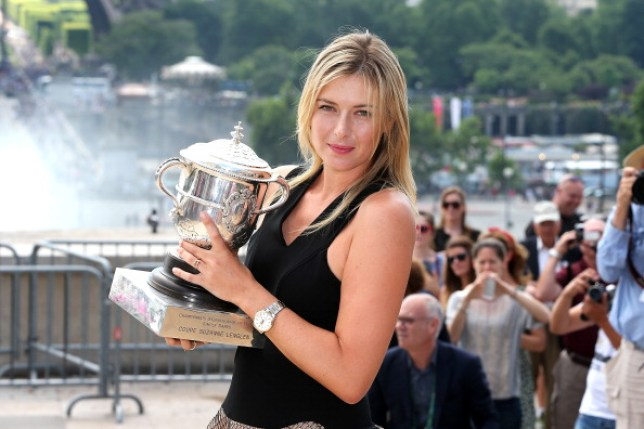 French Open women's champion Maria Sharapova of Russia poses with the Coupe Suzanne Lenglen backdropped by the Eiffel Tower after her victory on June 8, 2014 in Paris, France.