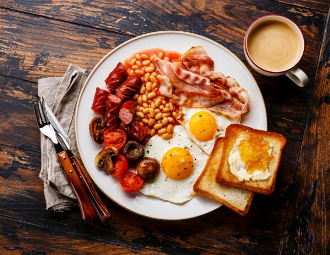 full english fryup breakfast, fried eggs, beans, toast, bacon, sausages, mushrooms