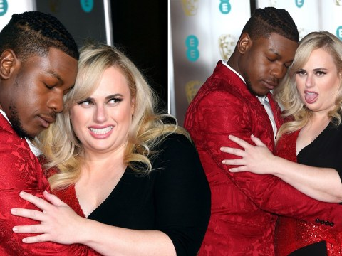 Rebel Wilson and John Boyega are a couple's dream as they hug it out on Baftas after party red carpet