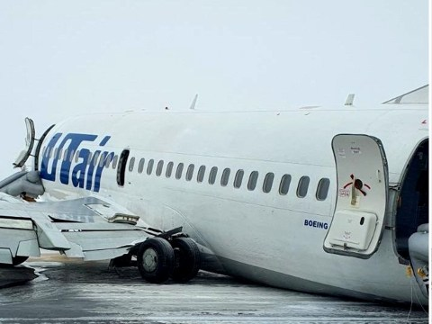 Plane with almost 100 passengers crash-lands and skids across icy runway