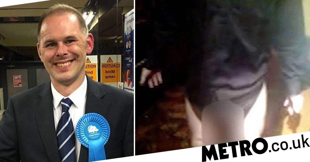 Tory MP filmed flashing at young woman in a pub