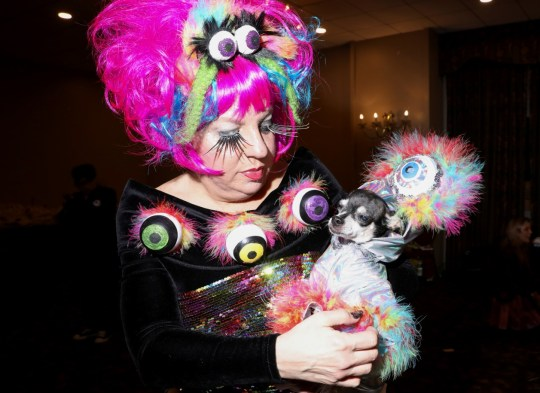 A woman holds dog at the 17th annual New York Pet Fashion Show