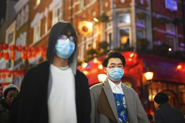 People wearing masks in China Town, London, as two people in the UK have tested positive for Coronavirus. PA Photo. Picture date: Saturday February 1, 2020. Health chiefs confirmed on Friday that two people in York had tested positive for the virus - which has killed 259 people in China. See PA story HEALTH Coronavirus. Photo credit should read: Victoria Jones/PA Wire