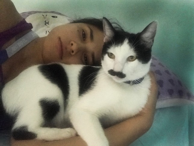 Alberto the cat with a moustache and owner Claudia