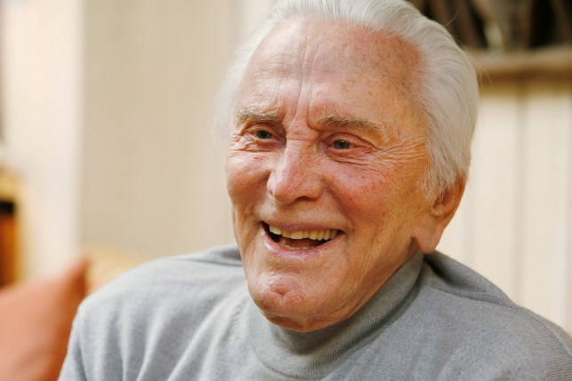 "FILE PHOTO: Actor Kirk Douglas, 90, is photographed during an interview about his life, film career and his new book ""Let's Face It,"" at his home in Beverly Hills, California, April 26, 2007. REUTERS/Fred Prouser/File Photo"