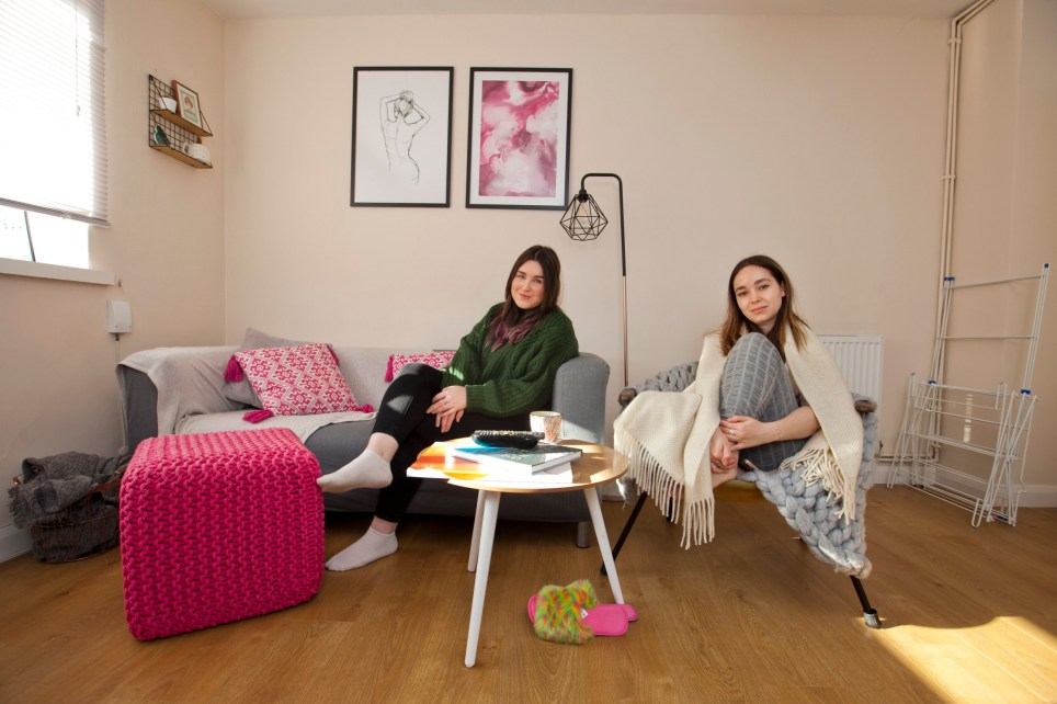 What I Rent... Jemma Lamble (green Jumper) in her flat in Motspur Park, south west London. Jenna shares the flat with friend Georgia Seago (wrap scarf) ?? photograph by David Sandison www.dsandison.com