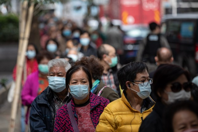 People in China wearing face masks in the street