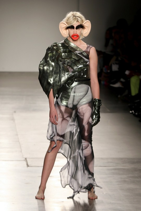 NEW YORK, NEW YORK - FEBRUARY 07: A model walks the runway wearing Junkai Huang during the Fashion Institute Of Technology's Fine Art Of Fashion And Technology Show at Pier 59 Studios on February 07, 2020 in New York, New York. (Photo by Bennett Raglin/Getty Images for Fashion Institute Of Technology)