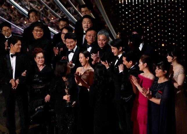 """Kwak Sin Ae and Bong Joon-ho win the Oscar for Best Picture for """"Parasite"""" at the 92nd Academy Awards"""