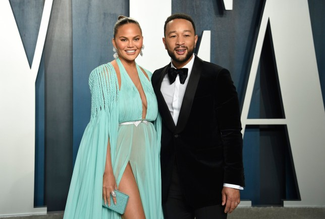 Chrissy Teigen, left, and John Legend arrive at the Vanity Fair Oscar Party on Sunday, Feb. 9, 2020, in Beverly Hills, Calif. (Photo by Evan Agostini/Invision/AP)