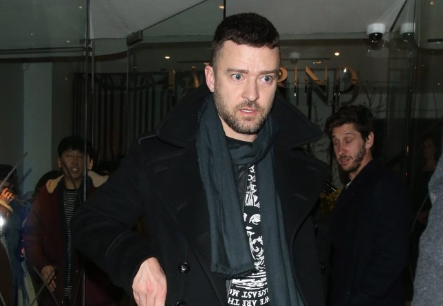 13 February 2020. Justin Timberlake seen leaving Tamarind Restaurant in Mayfair, London. Justin left wearing a scarf and a large black Tom Ford coat. Pictured: Justin Timberlake Credit: GoffPhotos.com Ref: KGC-49