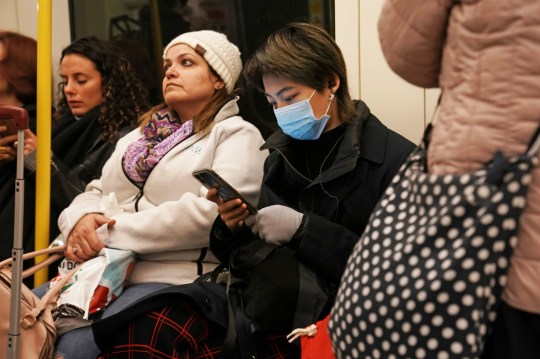 A woman wearing a mask on the London Underground. PA Photos. Picture date: Thursday February 13, 2020. See PA HEALTH Coronavirus story. The photo credit should contain: Owen Humphreys / PA Wire