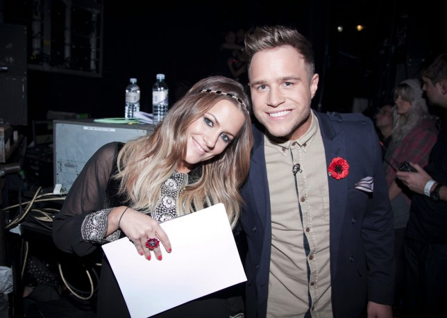Editorial use only. No book publishing. Mandatory Credit: Photo by Simco Ltd/REX (1488605ai) Caroline Flack and Olly Murs 'The X Factor TV Programme' London, Britain. - Nov 2011 Week 5