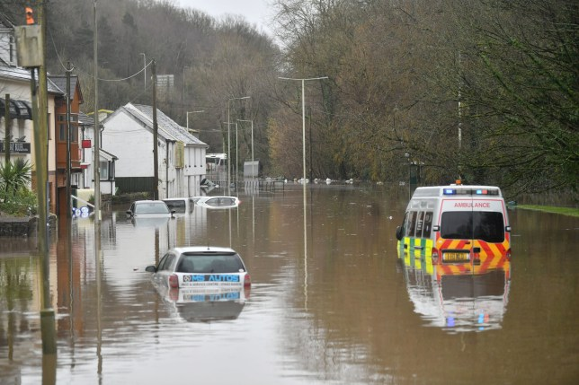 Cars in a flooded area of Nantgarw in Wales