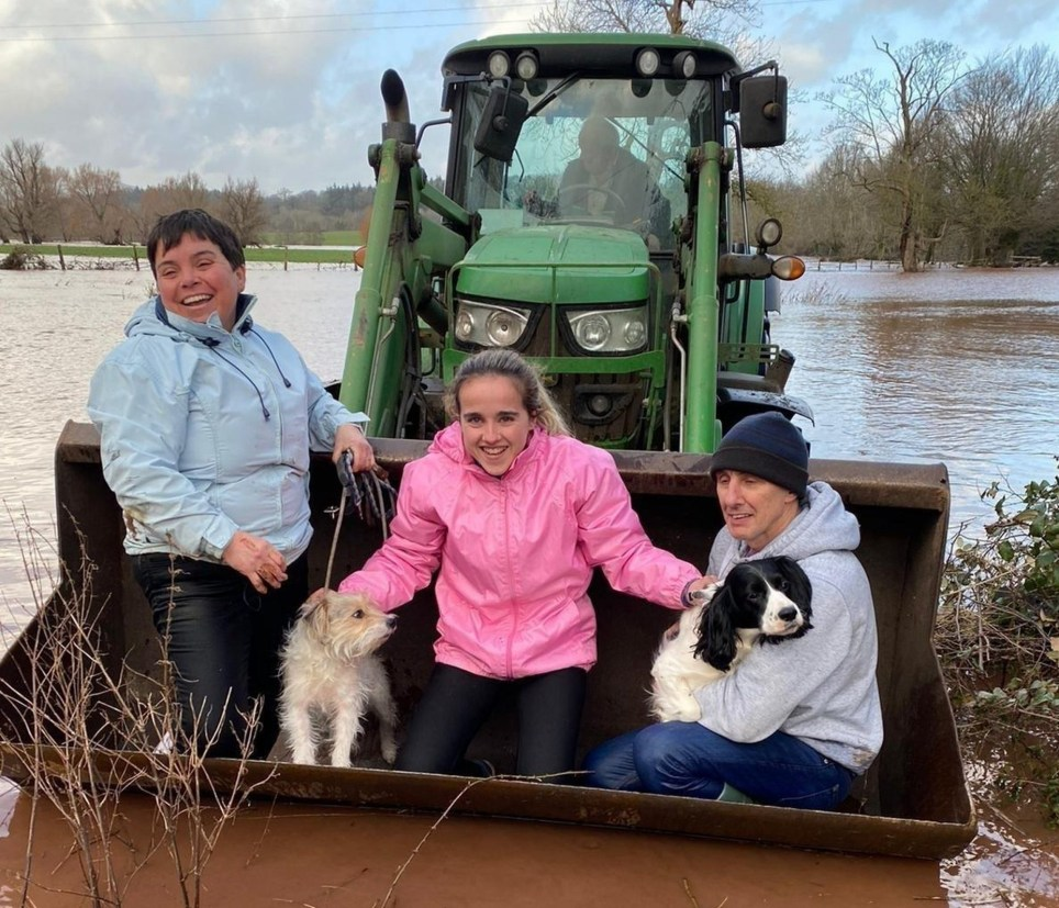 "COPY BY TOM BEDFORD Pictured: The Price family who were rescued in a bucket of a tractor. Re: A family in rural Monmouthshire was saved by a local farmer and his tractor on Sunday, after five feet of floodwater poured into their home, stranding them. Amy Price said she, her parents, and their two dogs were all trapped in the house for nine hours when Storm Dennis caused the River Usk to burst its banks next to their Llanover home. ""This is the worst it has ever flooded,"" she said. ""The noise it was making was horrendous ? it was so scary."" Flood alerts had been put out for the area on Saturday, but nothing could have prepared the family for the extent of that night's rainfall and flooding."