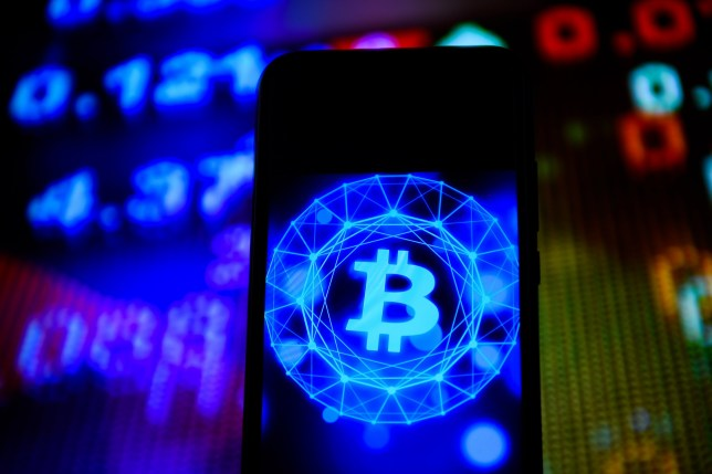 The Bitcoin logo seen displayed on a smartphone.