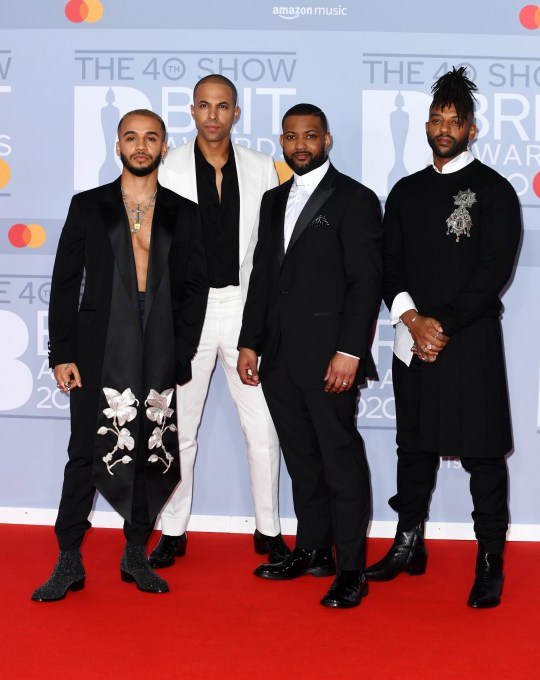 LONDON, ENGLAND - FEBRUARY 18: (EDITORIAL USE ONLY) (L to R) Aston Merrygold, Marvin Humes, JB Gill and Oritse Williams of JLS attend The BRIT Awards 2020 at The O2 Arena on February 18, 2020 in London, England. (Photo by Gareth Cattermole/Getty Images)