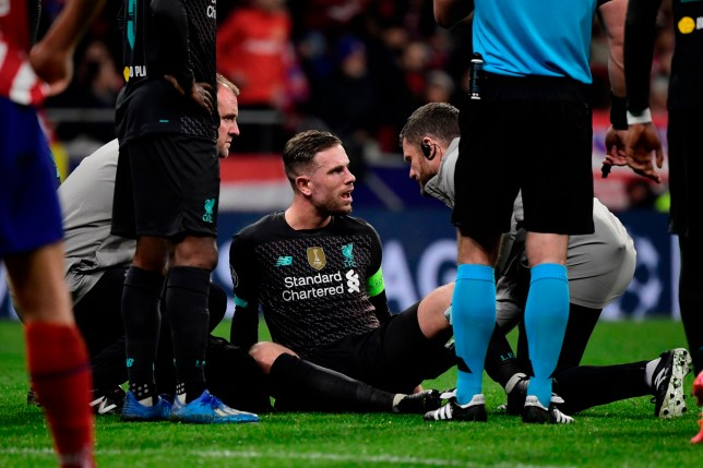Liverpool's English midfielder Jordan Henderson sits on the field during the UEFA Champions League, round of 16, first leg football match between Club Atletico de Madrid and Liverpool FC at the Wanda Metropolitano stadium in Madrid on February 18, 2020. (Photo by JAVIER SORIANO / AFP) (Photo by JAVIER SORIANO/AFP via Getty Images)