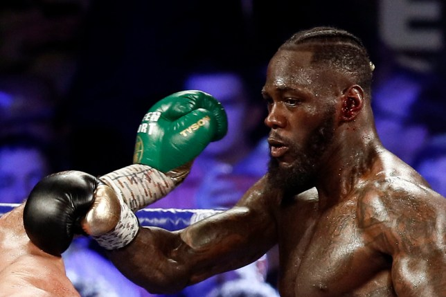 epa08239592 Deontay Wilder of the USA bleeds from his left ear during his WBC World Heavyweight Championship title fight against Tyson Fury of Britain at the Garden Arena in Las Vegas, Nevada, USA, 22 February 2020. EPA/ETIENNE LAURENT