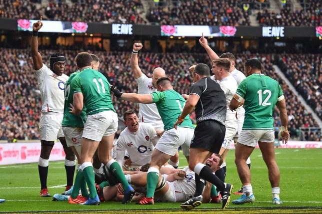 England players celebrate after England's hooker Luke Cowan-Dickie scores a try during the Six Nations international rugby union match between England and Ireland at the Twickenham, west London, on February 23, 2020. (Photo by Glyn KIRK / AFP) (Photo by GLYN KIRK/AFP via Getty Images)