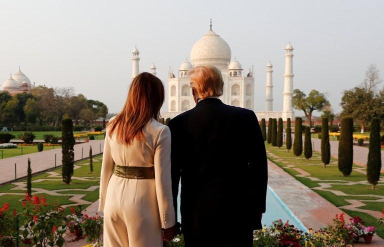 Photo of the Trumps gazing at the Taj Mahal