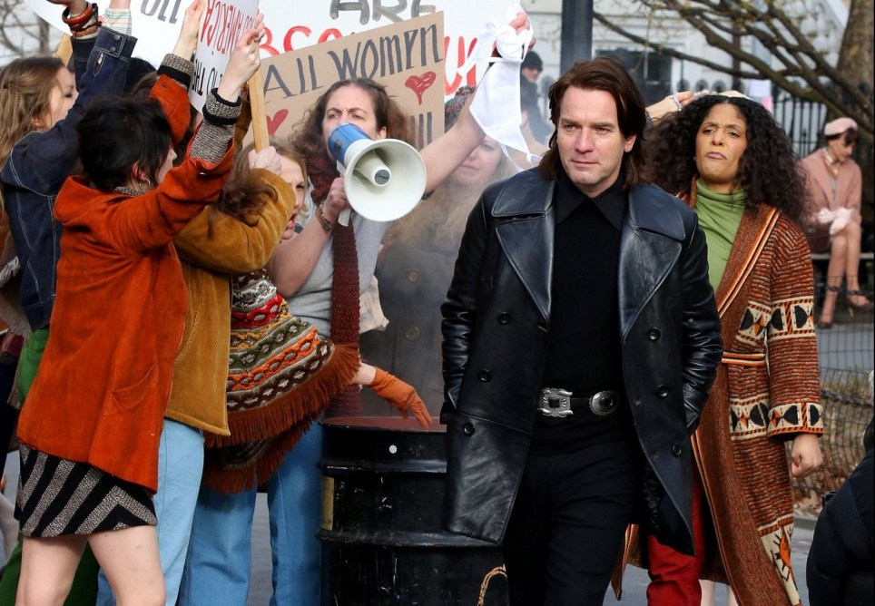 "Ewan McGregor portrays the late 1970s American fashion designer Roy Halston Frowick while filming ""Simply Halston"" in Manhattan's Washington Square Park. Ewan was seen passing through a women's protest for the scene. 24 Feb 2020 Pictured: Ewan McGregor. Photo credit: LRNYC / MEGA TheMegaAgency.com +1 888 505 6342"