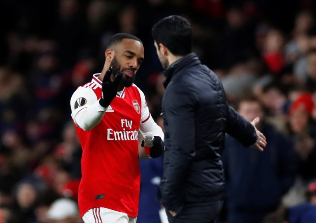 Soccer Football - Europa League - Round of 32 Second Leg - Arsenal v Olympiacos - Emirates Stadium, London, Britain - February 27, 2020 Arsenal's Alexandre Lacazette shakes hands with manager Mikel Arteta as he is substituted off Action Images via Reuters/Paul Childs