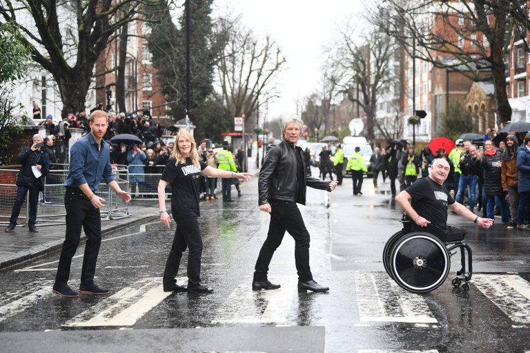 The Duke of Sussex, Jon Bon Jovi and members of the Invictus Games Choir walk on the famous zebra crossing outside the Abbey Road Studios in London. PA Photo. Picture date: Friday February 28, 2020. They are recording a special single in aid of the Invictus Games Foundation at the studios. See PA story ROYAL Sussex. Photo credit should read: Victoria Jones/PA Wire
