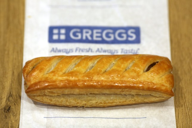 A sausage roll sits on a customer's table in a Greggs Plc sandwich chain outlet in Caterham, U.K., on Thursday, Oct. 22, 2015. Same-store sales at Greggs have grown 5.6 percent so far in 2015, up from 3.9 percent across the same period last year, and the company said on Oct. 6 that full-year growth will exceed its previous forecast slightly. Photographer: Chris Ratcliffe/Bloomberg via Getty Images