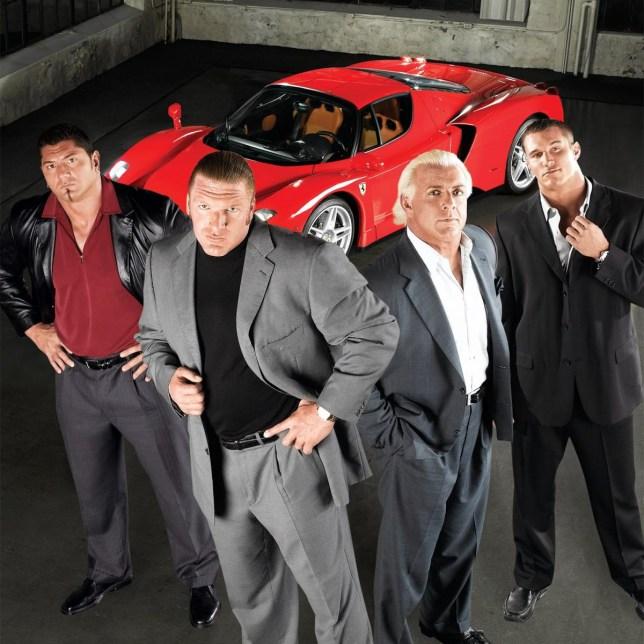 Evolution members Batista, Triple H, Ric Flair and Randy Orton