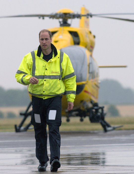 Britain's Prince William walks away from his helicopter as he begins his new job as a co-pilot with the East Anglian Air Ambulance (EAAA) at Cambridge Airport, Britain July 13, 2015. Stefan Rousseau/pool - RTX1K6QI