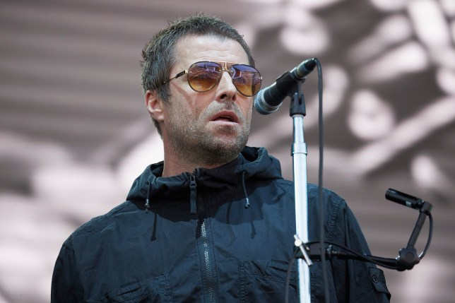 Liam Gallagher performing on stage in Berlin