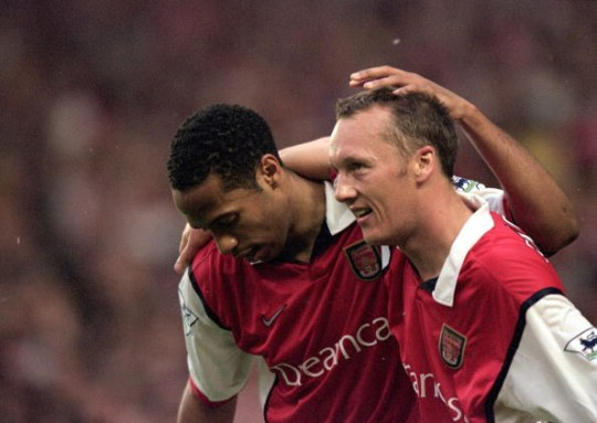 May 9, 2000: Thierry Henry and Lee Dixon of Arsenal celebrate in the FA Carling Premiership game against Sheffield on Wednesday at Highbury in London. The match was a 3-3 draw. Mandatory Credit: Jamie McDonald / Allsport (Credits: Getty Images)