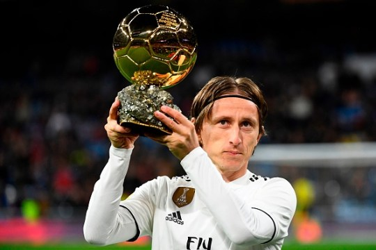 TOPSHOT - Real Madrid's Croatian midfielder Luka Modric poses with his Ballon d'Or trophy before the Spanish League football match between Real Madrid and Rayo Vallecano at the Santiago Bernabeu stadium in Madrid on December 15, 2018. (Photo by GABRIEL BOUYS / AFP)        (Photo credit should read GABRIEL BOUYS/AFP via Getty Images)