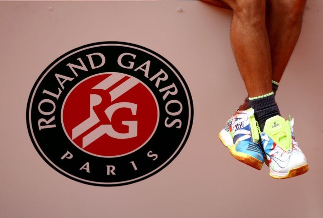 PARIS, FRANCE - JUNE 09: A detailed view of the shoes of Rafael Nadal of Spain as he celebrates victory on the podium following the mens singles final against Dominic Thiem of Austria  during Day fifteen of the 2019 French Open at Roland Garros on June 09, 2019 in Paris, France. (Photo by Julian Finney/Getty Images)