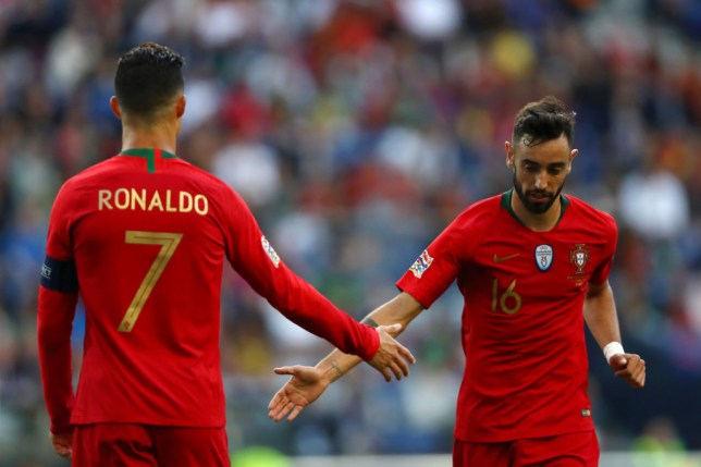PORTO, PORTUGAL - JUNE 09: Cristiano Ronaldo of Portugal speaks with Bruno Fernandes of Portugal during the UEFA Nations League Final between Portugal and the Netherlands at Estadio do Dragao on June 09, 2019 in Porto, Portugal. (Photo by Dean Mouhtaropoulos/Getty Images)